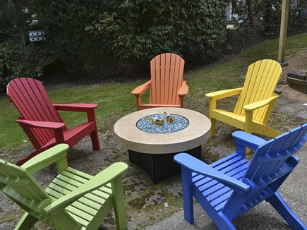 Harwich Cape Cod vacation rental - Patio with Ice Bucket Table and Adirondack Chairs