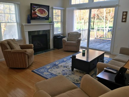 New Seabury, Mashpee New Seabury vacation rental - Living area with TV and access to the deck