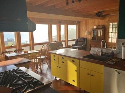 Wellfleet Cape Cod vacation rental - Kitchen view towards dining room (ocean in windows).