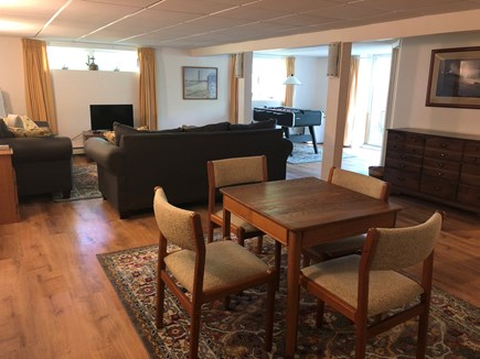 Harwich Cape Cod vacation rental - Daylight basement with 2 sofas, TV, card table & foosball table