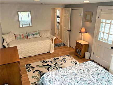 Orleans Cape Cod vacation rental - Large sunny bedroom with 1 Queen and trundle bed (two twin beds).
