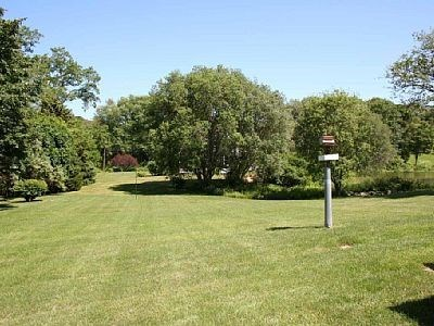 Orleans Cape Cod vacation rental - Huge level back yard for the kids to play in.