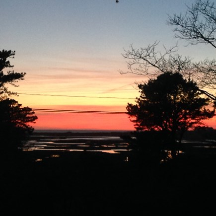 Eastham Cape Cod vacation rental - Sunset from our property overlooking the marsh and bay