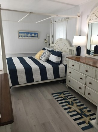 Eastham Cape Cod vacation rental - Master Bedroom of First Floor with Slider to Deck and View of Bay