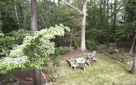Brewster Cape Cod vacation rental - Backyard with seating around fire pit