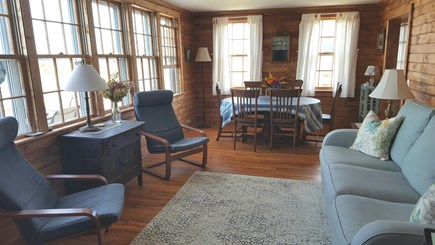 Sagamore Beach Cape Cod vacation rental - Living room with wall of windows facing the water.
