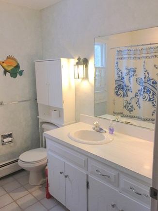 Harwich Cape Cod vacation rental - First floor bathroom with tub/shower, toilet and sink