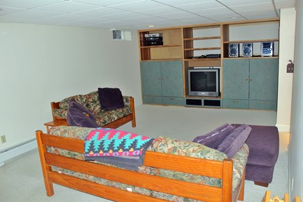 Harwich Cape Cod vacation rental - Lower level living area with TV
