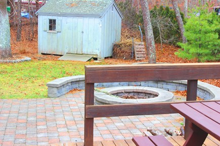 Harwich Cape Cod vacation rental - Outdoor Deck with Table and Fire Pit Area