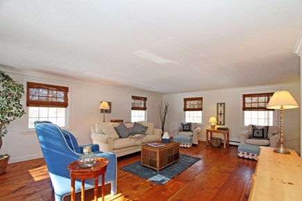 East Brewster Cape Cod vacation rental - Sunny and bright family room w/ large flat screen, games & books