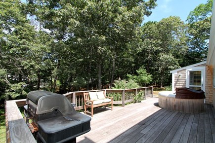 East Brewster Cape Cod vacation rental - Large back deck and yard with Weber grill.