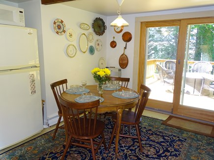 Orleans Cape Cod vacation rental - Dining area in kitchen, slider to back deck