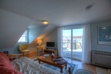Orleans Cape Cod vacation rental - Living area opens onto deck with marsh views beyond.