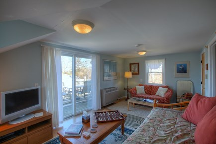 Orleans Cape Cod vacation rental - Sitting area in living room with loveseat.