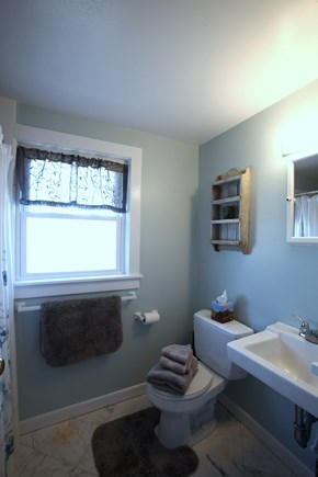 Orleans Cape Cod vacation rental - Cozy bathroom with plenty of shelf space.