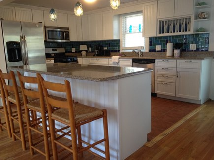 Harwich Cape Cod vacation rental - Updated kitchen with Quartz countertops and island seating.