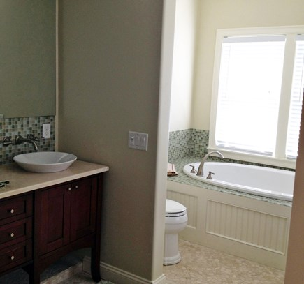 Dennis Cape Cod vacation rental - Master spa whirlpool with large mirror and double sinks.