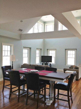 Dennis Cape Cod vacation rental - View of dining area and living area with flat screen TV.