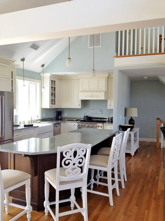 Dennis Cape Cod vacation rental - View of gourmet kitchen, island and loft area from LR area.