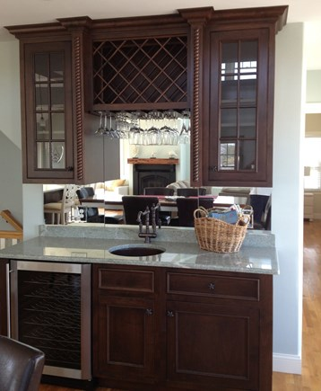 Dennis Cape Cod vacation rental - Wet bar with wine glasses and wine fridge in dining area.