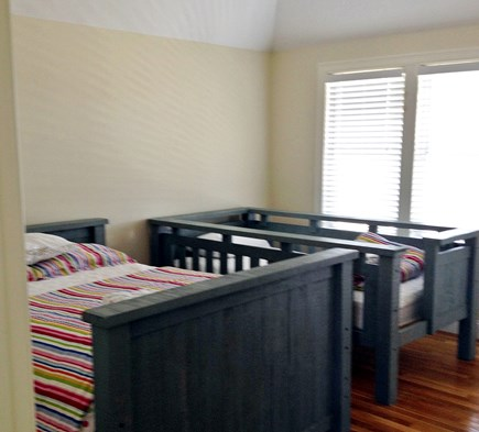 Dennis Cape Cod vacation rental - #1 first floor double and twin room with dresser and closet.