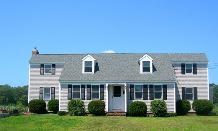 Hyannis Cape Cod vacation rental - Exterior- Door to patio off left side of house