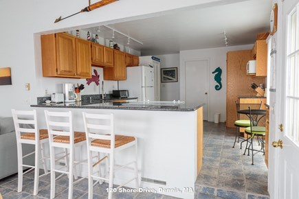 Dennis Cape Cod vacation rental - work on a puzzle or chat with the chef on the bar stools