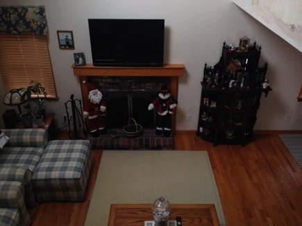 West Yarmouth Cape Cod vacation rental - Living Room View From Stairs, TV Over the Fireplace