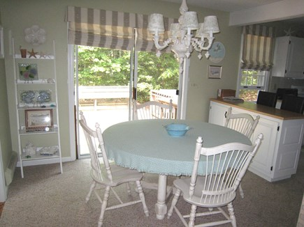 Dennis Village Cape Cod vacation rental - Beyond foyer area is dining with slider to deck