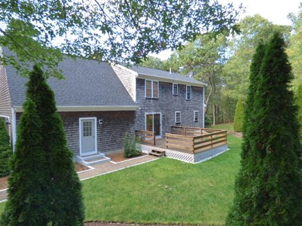 South Dennis Cape Cod vacation rental - Back deck, has gas grill and outside furniture.