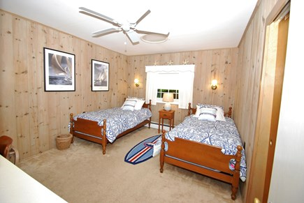 East Orleans Cape Cod vacation rental - Bedroom with 2 twin beds, ceiling fan, desk with book shelves.