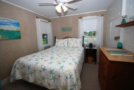 East Orleans Cape Cod vacation rental - Bedroom with queen bed, ceiling fan located off kitchen.