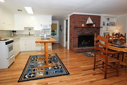 East Orleans Cape Cod vacation rental - Freshly painted kitchen with fireplace and granite counter top.