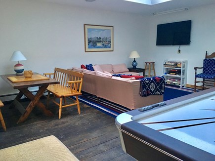 East Orleans Cape Cod vacation rental - Game room with air hockey table and doors that open to patio with