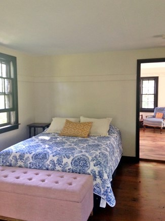 Harwich Cape Cod vacation rental - Studio bedroom, queen bed, with living room in background.