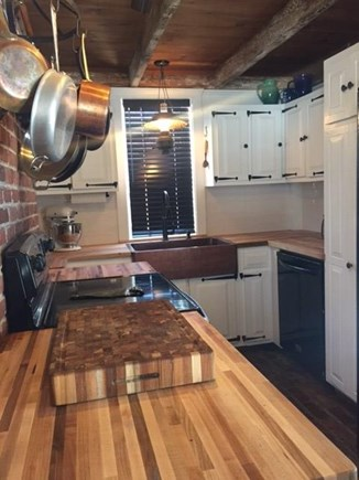 Harwich Cape Cod vacation rental - Updated kitchen with subway tiles and butcher block counters.