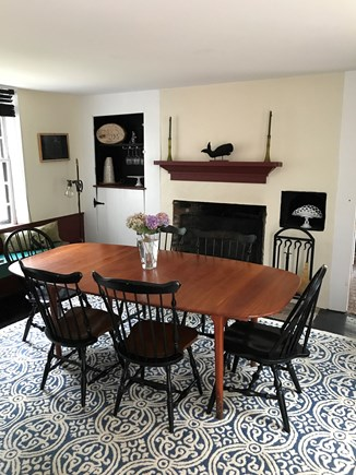 Harwich Cape Cod vacation rental - Dining room with new area rug.  Door to kitchen is in the back.