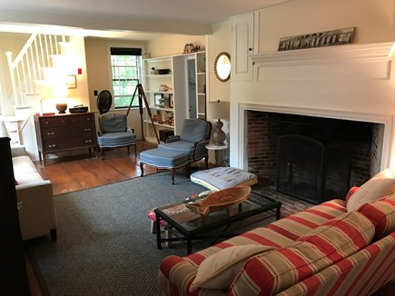 Harwich Cape Cod vacation rental - Large living room with two couches, stairs to second floor.