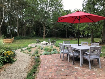Harwich Cape Cod vacation rental - New patio and fire pit with entire property fenced-in.
