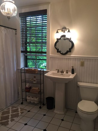Harwich Cape Cod vacation rental - First floor master bathroom with access from living room.