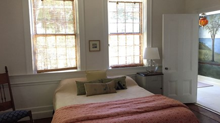 Harwich Cape Cod vacation rental - Queen bed in first floor bedroom with hallway mural in background