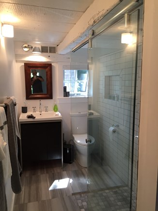 Provincetown Cape Cod vacation rental - New bathroom with an open bath and beach towel closet
