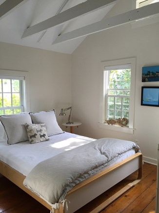 Provincetown Cape Cod vacation rental - Front bedroom with queen size bed, closet and chest of drawers.