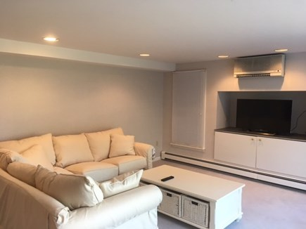 Brewster Cape Cod vacation rental - Lower level family room with TV and views of Cape Cod Bay