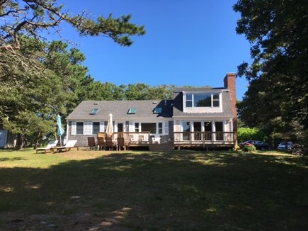 Chatham Cape Cod vacation rental - Backyard with deck area and water views