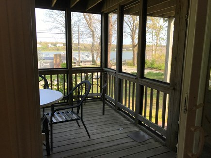 Eastham Cape Cod vacation rental - 1st floor screened in porch off the dining area.