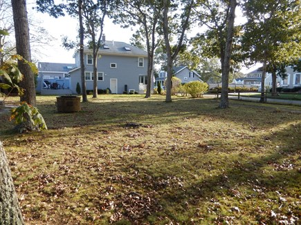 Falmouth Heights Cape Cod vacation rental - Back yard with view of deck in back of the house