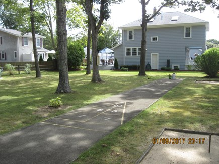 Falmouth Heights Cape Cod vacation rental - Shuffle board and horse shoes in yard