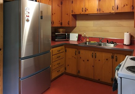 Eastham Cape Cod vacation rental - Kitchen with shiplap siding and many updates