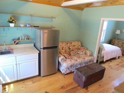 Brewster Cape Cod vacation rental - Bunk house living room with couch, sink, fridge, flat screen tv